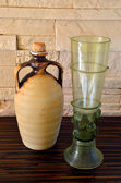 Ceramich pitcher and green wine glass — Foto Stock