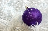 Christmas purple ball on white needless — Stock Photo