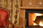 Old ancient chair and fireplace — Stok fotoğraf