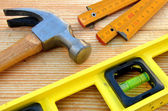 Claw hammer, carpenter meter, water-level — Stock Photo