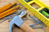 Claw hammer, carpenter meter, water-level and nails — Stock Photo