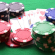Red, blue, green, white and black poker chips and royal flush — Stock Photo #63162527