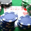 Red, blue, green, white and black poker chips and royal flush — Stock Photo #63162559