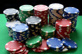Red, blue, green, white and black poker chips pile — Stock Photo
