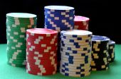 Red, blue, green, white and black poker chips columns — Stock Photo