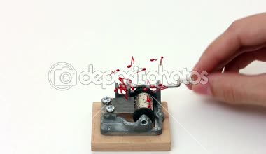 Music notes flying out of music box on white background — Stock Video
