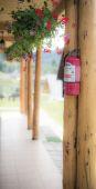 Extinguisher in the corner — Stock Photo