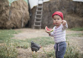 Sweet toddler eating a sweet watermelon — Stock Photo