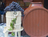 Black grape and brown cask — Stock Photo