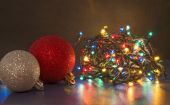 Colorful Christmas lights and shiny baubles — Foto de Stock