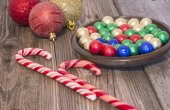 Christmas candy cane and globes — Stock Photo