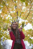 Happy young woman under the tree — Zdjęcie stockowe