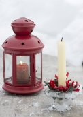 Lamp and snow and Christmas candle on snowy background — Stock Photo