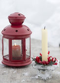 Lamp and snow and Christmas candle on snowy background — Stockfoto