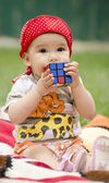 Toddler playing with a cube — Stock Photo