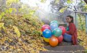 Meditative girl with her balloons — Stock Photo
