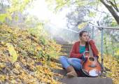 Meditative girl with her guitar — Stock Photo