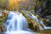 Waterfall in autumn season — Stock Photo