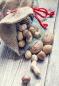 Bag full of nuts and almonds — Stock Photo
