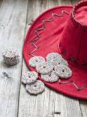 Christmas chocolate on a red hat — Stock Photo