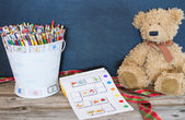 Bucket of pencils, old bear and  coloring book — Stock Photo