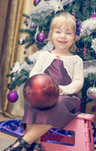 Little and happy girl having fun decorating — Stock Photo
