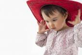 Little girl with red cowboy hat — Stock Photo