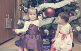 Little girls near the Christmas tree — Stock Photo