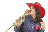 Beautiful girl with rose, heart and red hat — Stock Photo