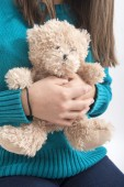 Girl holding teddybear, closeup — Stock Photo