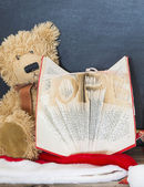 Old bear and vintage old book — Stock Photo