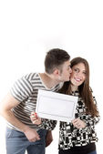 Young couple announcing their baby — Foto Stock