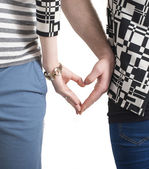 Couple hands touching fingers in the shape of heart — Stock Photo