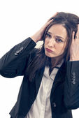 Tired businesswoman having huge headache — Stock Photo