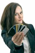 Woman with many different credit cards. Isolated on white — Stock Photo