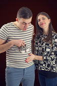 Young couple announcing their baby isolated — Стоковое фото
