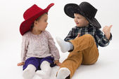 Two brothers smiling wearing cowboy hats — Stock Photo