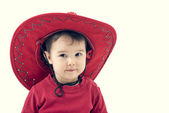 Girl cowboy in a red hat on a white background. — Stock Photo