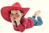 Little cowgirl in a red hat posing on a white background — Stock Photo