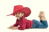 Happy  little girl cowboy in a red hat on a white background — Stock Photo