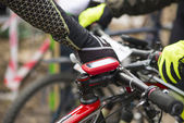 Modern electronic gps device attached to bicycle handlebar — Stock Photo