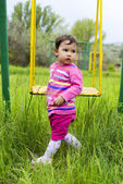Little girl on the swing — Stockfoto