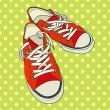 Pair of red sneakers — Stock Vector #59286777