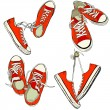 Four pairs of red sneakers — Stock Vector #59287695
