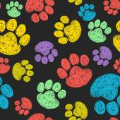 Pattern with colorful paw prints — Stock Vector