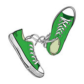 Pair of green sneakers — Stock Vector