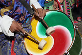 Man with traditional dress playing drums at the inaugural procession of the Ladakh Festival — Stock Photo