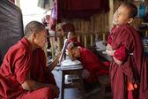 An unidentified Buddhist monk and novice — Stock Photo