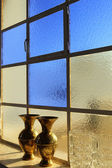 Blue window with vases in a Greek orthodox church — Stock Photo