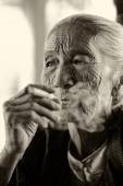 Old woman with a cigar , Myanmar, Burma — Stock Photo